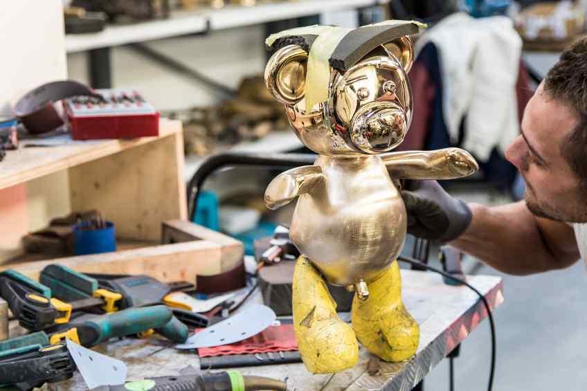 Working on the small Bare Hug in the studio - Bare Hug (polished bronze), 2016 by Joseph Klibansky