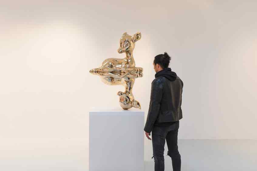 "Joseph standing next to the large ""Reflections of Youth"" - Reflections of Youth (polished bronze), 2017 by Joseph Klibansky"