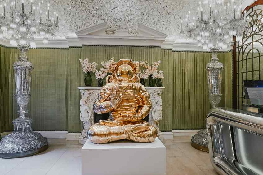 At Annabe's Mayfair, London, UK, entrance - White Universe (bronze), 2019 by Joseph Klibansky