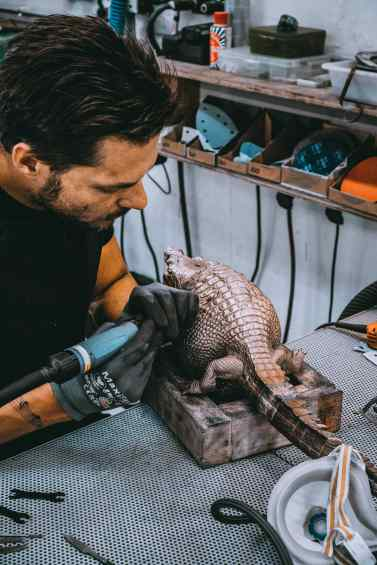 "A studio assistent working on the sculpture ""Happily Ever After"" in Klibansky's Studio - Happily Ever After (bronze), 2018 by Joseph Klibansky"