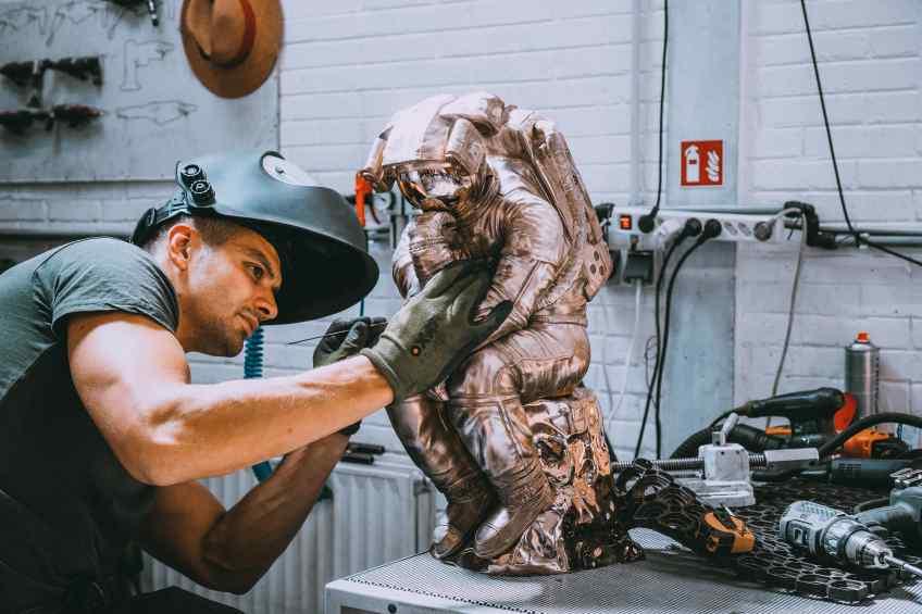 Studio assistant working on the bronze Thinker - The Thinker (bronze), 2018 by Joseph Klibansky
