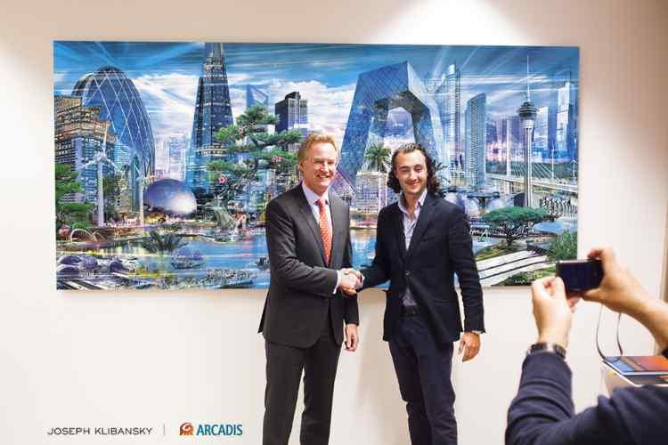 Joseph Klibansky shaking the hand of Niel McArthy (CEO Arcadis NV) - ARCADIS N.V. commisions Joseph Klibansky for 125 year anniversary