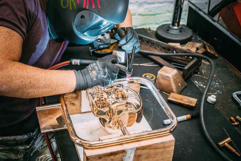 Studio assistant working on Elements of Immortality in the studio - Element of Immortality (polished bronze), 2018 by Joseph Klibansky
