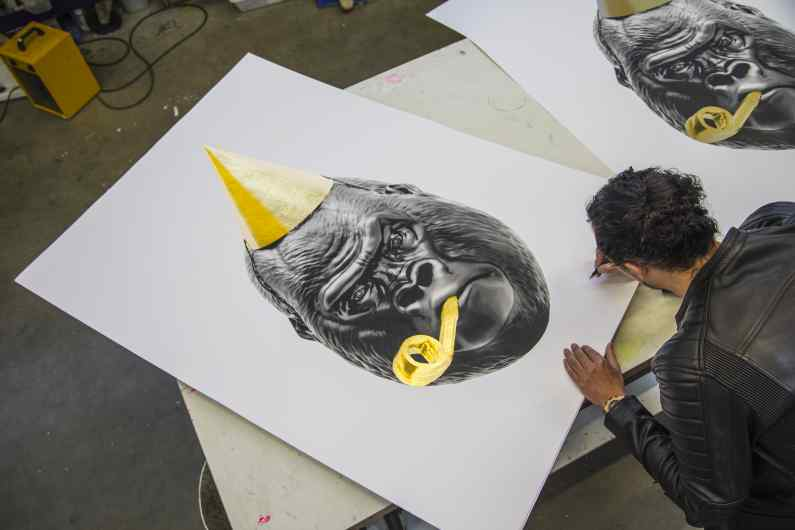 Joseph signing and numbering a large Big Bang screen print. - Big Bang (edition, black/gold leaf), 2016 by Joseph Klibansky