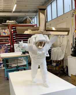 """The installation of """"Leap of Faith"""" one of my bronze sculptures weighing approximately 150kg.. the white space suit is painted bronze and the cross is polished to a high gloss..#contemporaryart #sculpture #streetart #josephklibansky #modernart"""