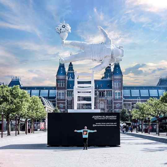 """Guys... we are open for photos!  I'm really really pinching myself that my sculpture """"Self portrait of a dreamer"""" is now installed on this mind blowing location in #amsterdam  thank you to everyone that  takes pictures and shares this moment with me, my family and my ridiculously hard working team.. I love you all!!! ❤️❤️❤️ ps. Everyone that uses the hashtag #josephklibansky amd @josephklibansky  I will try to like all your photos! #selfportraitofadreamer #sculpture #art"""