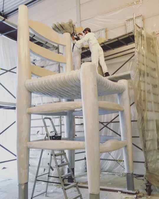 Here you can see the process of large sculpture making. The chair is made out of metal and hard foam that we sculpt by hand with a saw and knife, and as last a fiberglass like coating for strength and weather resistance. . #art #largescale #sculptures #artist