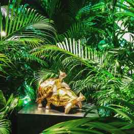 """The photo was taken in the """"Jungle Room"""" of my show at Palazzo Franchetti in Venice.We turned the whole room into a living jungle with filled with real plants and green lighting, specially to show my new sculpture """"Baby we Made it""""#josephklibansky #babywemadeit #palazzofranchetti #frieze #artnewyork #contemporaryart #artnews #amsterdam"""