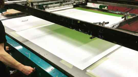 Here you see the meticulous hand process of silkscreening and layering ink, gold and palladium. A total of 20 layers to create the silkscreen of