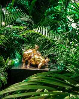 """This picture shows the first time we exhibited my mating turtles sculpture called """"Baby we made it""""I don't know if you can see the difference but this version had 24karat gold leaf instead of polished bronze.We created a large room full of jungle plants inside a venetian palace just to show this sculpture in an interesting context.. like a natural habitat but then in the wrong place..#art #sculpture #contemporaryart #josephklibamsky #artcontemporain"""