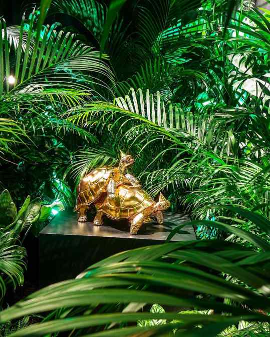 "This picture shows the first time we exhibited my mating turtles sculpture called ""Baby we made it"" I don't know if you can see the difference but this version had 24karat gold leaf instead of polished bronze. We created a large room full of jungle plants inside a venetian palace just to show this sculpture in an interesting context.. like a natural habitat but then in the wrong place . . #art #sculpture #contemporaryart #josephklibamsky #artcontemporain"