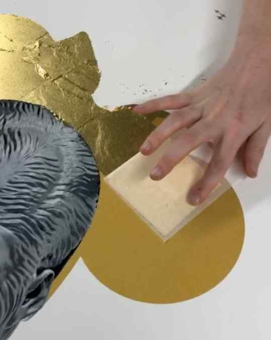 I wanted to show you a small part of our hand made screen-printing process. Here you can see how we lay down the 24 karat gold leaf on the paper.. after this step we can start building depth in the image by creating shadows and highlights..  The gorilla head itself is build up out of 12 different colors of ink 🖋  as you can see it nearly looks 3D .. it started as a white piece of paper  For interest please mail to: info@josephklibansky.com  #screenprinting #artprints #artprint #josephklibansky