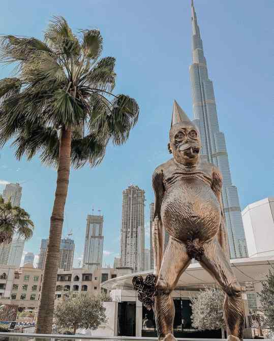"""My 4 meter tall sculpture """"Birthday Suit"""" on view at @galdubai with the stunning #burjkhalifa as a background.. anyone up for a cocktail in Dubai? 🍸"""